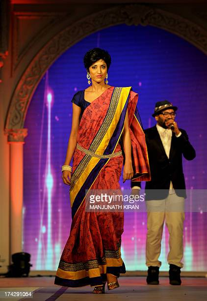An Indian model draped in a saree walks the ramp during a fashion show organised by the Indian ethnic fashion garment house 'Rajguru Rise' in...