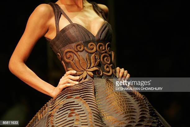 An Indian model presents a creation by Indian designer Rohit Bal on April 5 2009 during the grand finale of the Kolkata Fashion Week in Kolkata The...