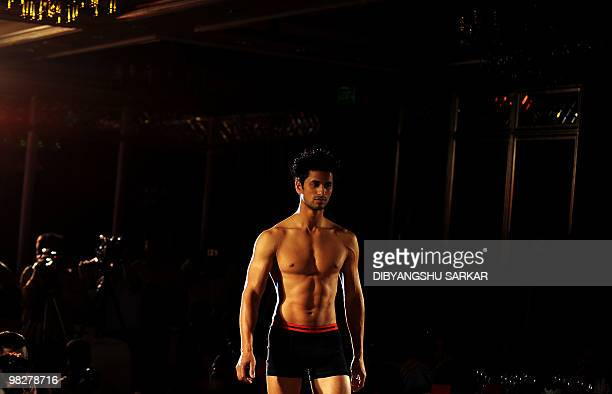 An Indian model presents a new men's underwear brand at a fashion show in Bangalore on April 6 2010 Indian brand Facit was launched to target the...
