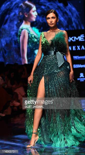 An Indian model presents creations by designer SS during a fashion show at Lakme Fashion Week Winter Festive 2019 in Mumbai on August 21 2019 / XGTY...