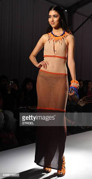 An Indian model showcases a creation by designer Babita Malkani during the India Resort Wear Fashion Week in Mumbai on late December 14 2013 AFP...
