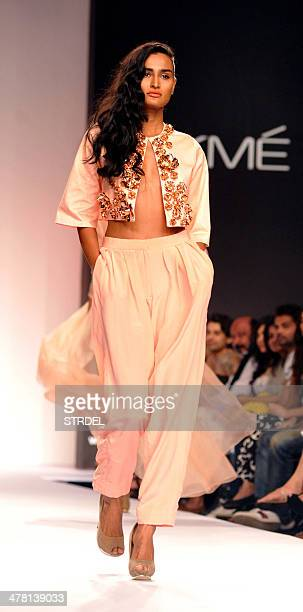 An Indian model showcases a creation by Nikhil Thampi on the second day of the Lakme Fashion Week Summer/Resort 2014 in Mumbai on March 12 2014 AFP...