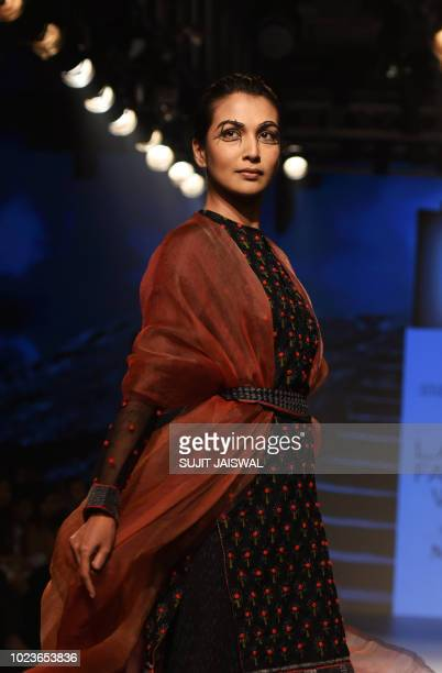 An Indian model showcases creations by designer Soumodeep Dutta at the Lakme Fashion Week Winter/Festive 2018 in Mumbai on August 26 2018