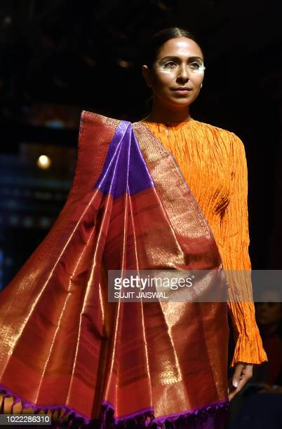 An Indian model showcases creations by designer Sunita Shankar in collaboration with the Khadi and Village Industries Commission at the Lakme Fashion...