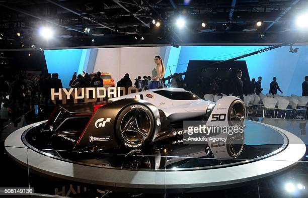 An Indian model stands next to Hyundai 2025 vision Grati Turismo at the Auto Expo in Greater Noida on the outskirts of Delhi February 03 2016