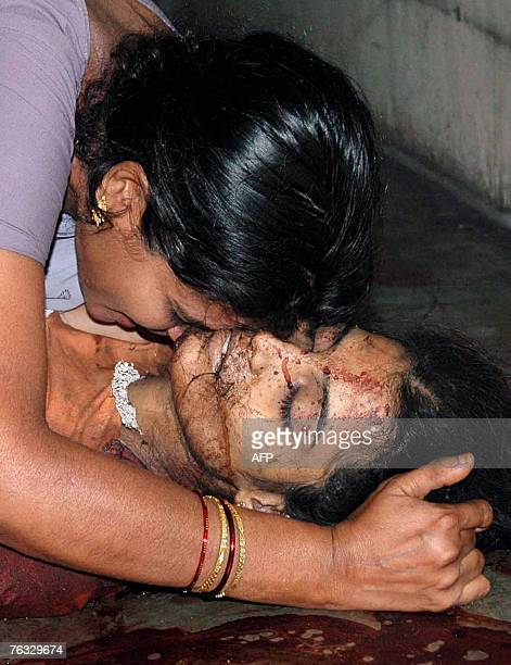 An Indian mother cries over the body of her daughter aspiring engineer student Sarala who died late 25 August in a blast at the Gokul Chat street...