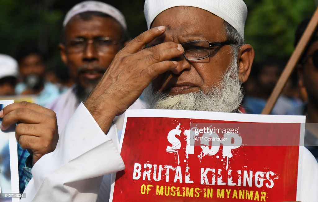 An Indian Muslim activist holds a placard during a a rally against the Myanmar government to protest the treatment of Rohingya Muslims in Myanmar, near the Consulate General of Myanmar, in Kolkata on September 7, 2017. Nobel peace laureate Malala Yousafzai and mainly Muslim countries in Asia led a growing chorus of criticism on September 4 aimed at Myanmar and its civilian leader and Nobel laureate Aung San Suu Kyi over the plight of the Rohingya Muslim minority. / AFP PHOTO / Dibyangshu SARKAR