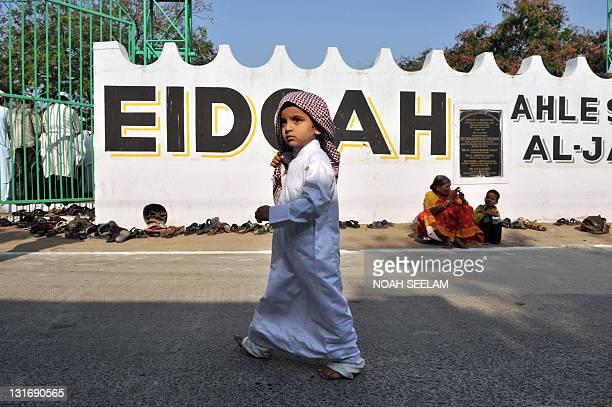 An Indian Muslim boy walks towards the morning prayers of the Eid AlAdha festival at Ahle Sunnat AlJamat Eidgah in Hyderabad on November 7 2011...