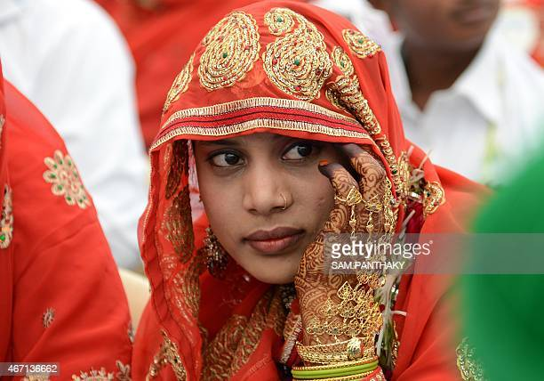 An Indian Muslim bride looks on during a mass wedding ceremony at the ancient Sarkhej Roza mosque and tomb complex in Ahmedabad on March 21 2015 Some...