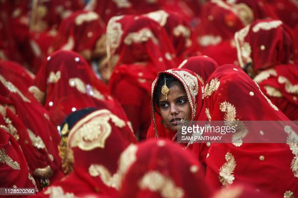 An Indian Muslim bridetobe looks on as she participates in a mass wedding ceremony in Ahmedabad on March 3 2019