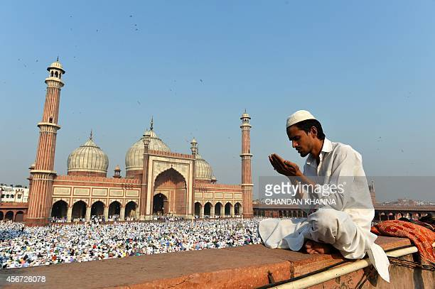 An Indian Muslim devotee offers prayers during Eid alAdha at Jama Masjid in New Delhi on October 6 2014 Muslims across the world are preparing to...