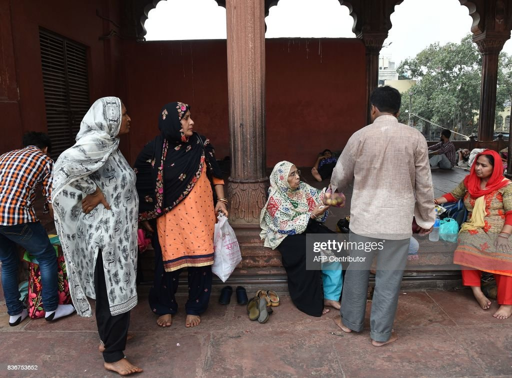 An Indian Muslim family visits the Jama Masjid mosque in New Delhi on August 22, 2017. India's top court on August 22 banned a controversial Islamic practice that allows men to divorce their wives instantly, ending a long tradition that many Muslim women had fiercely opposed. PHOTO / Prakash SINGH