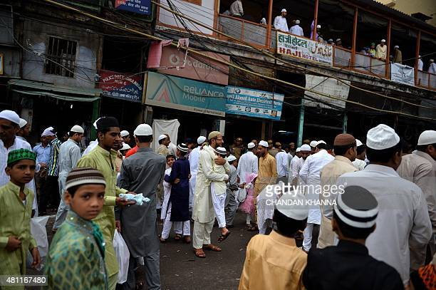 An Indian Muslim father hugs his son before offering prayers during Eid alFitr in the old quarters of New Delhi on July 18 2015 Muslims around the...
