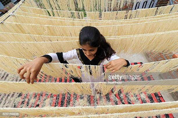 An Indian muslim girl dries 'Vermicelli' used to make a traditional sweet dish popular during the Islamic holy month of Ramadan in Jaipur India...