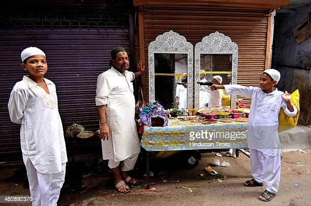 An Indian Muslim kid trying his hand on toygun during a fair on the occasion of Eidulfitr in the old quarter of city on July 29 2014 in New Delhi...