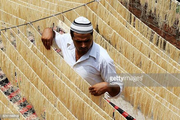 An Indian muslim man dries 'Vermicelli' used to make a traditional sweet dish popular during the Islamic holy month of Ramadan in Jaipur India...