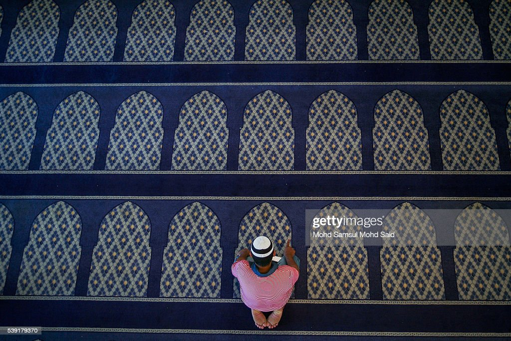 An Indian Muslim man is seen performing a prayer inside the India Muslim mosque during the holy month of Ramadan on June 10, 2016 in Klang, Malaysia. Muslims around the world including Indonesia, Thailand and Arab state are observing the fasting month of Ramadan, Islam's holiest month, during which observant believers fast from dawn to dusk. They celebrate the end of the Ramadan with Eid al-Fitr festival.