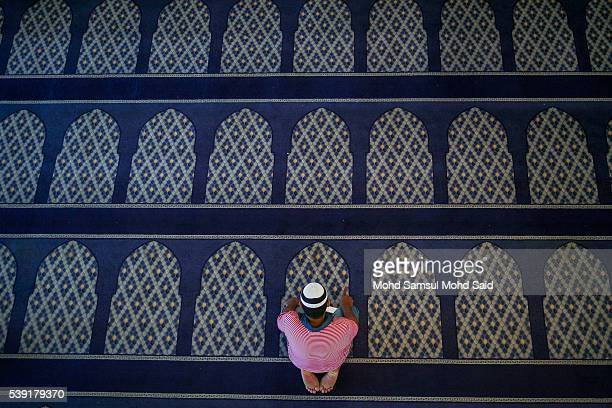 An Indian Muslim man is seen performing a prayer inside the India Muslim mosque during the holy month of Ramadan on June 10 2016 in Klang Malaysia...