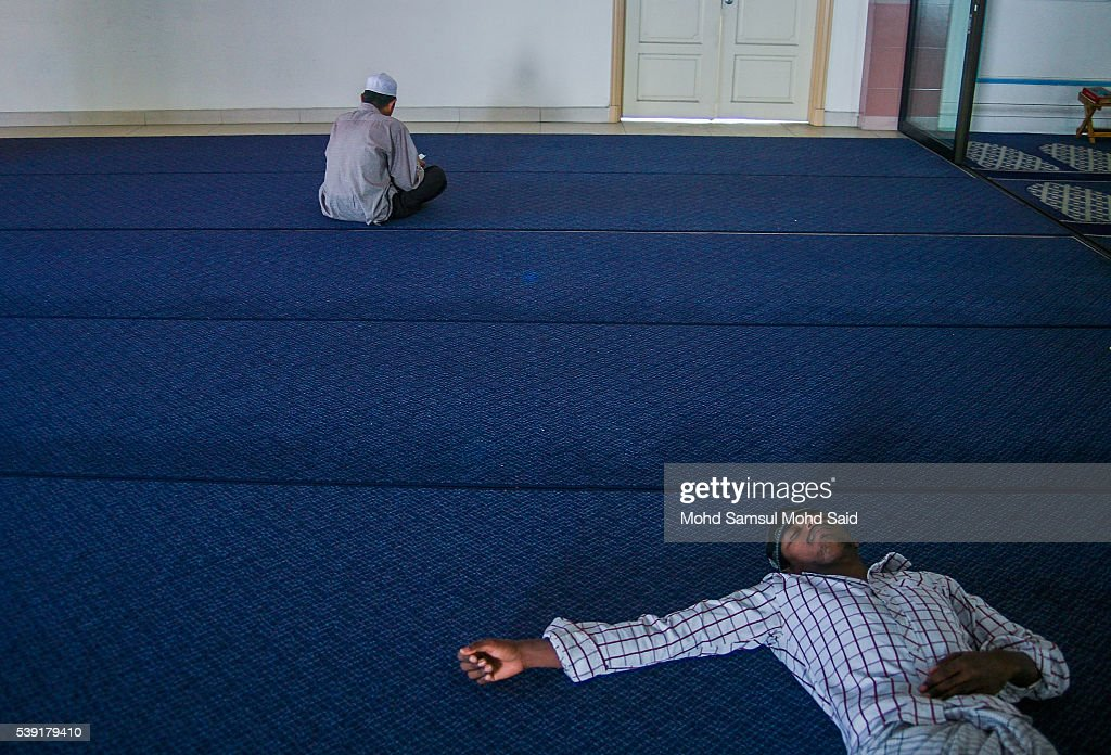 An Indian Muslim man is seen sleep inside the India Muslim mosque during the holy month of Ramadan on June 10, 2016 in Klang, Malaysia. Muslims around the world including Indonesia, Thailand and Arab state are observing the fasting month of Ramadan, Islam's holiest month, during which observant believers fast from dawn to dusk. They celebrate the end of the Ramadan with Eid al-Fitr festival.