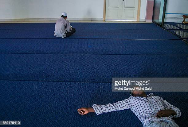 An Indian Muslim man is seen sleep inside the India Muslim mosque during the holy month of Ramadan on June 10 2016 in Klang Malaysia Muslims around...