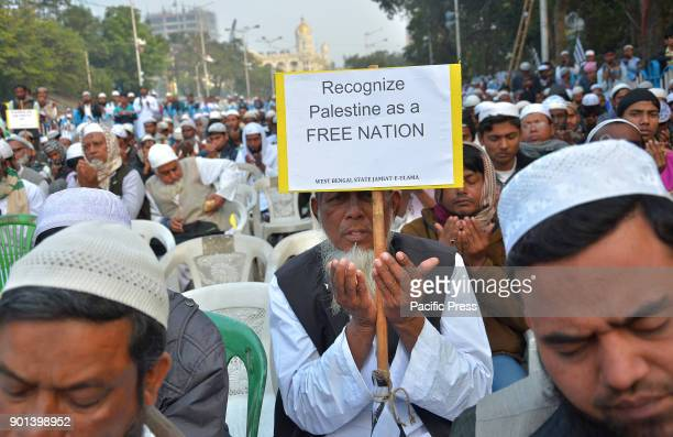 An Indian Muslim man prayer for the Al Aqsa mosque in the Old City of JerusalemWest Bengal State Jamait Ulama EHind activists and supporters during a...