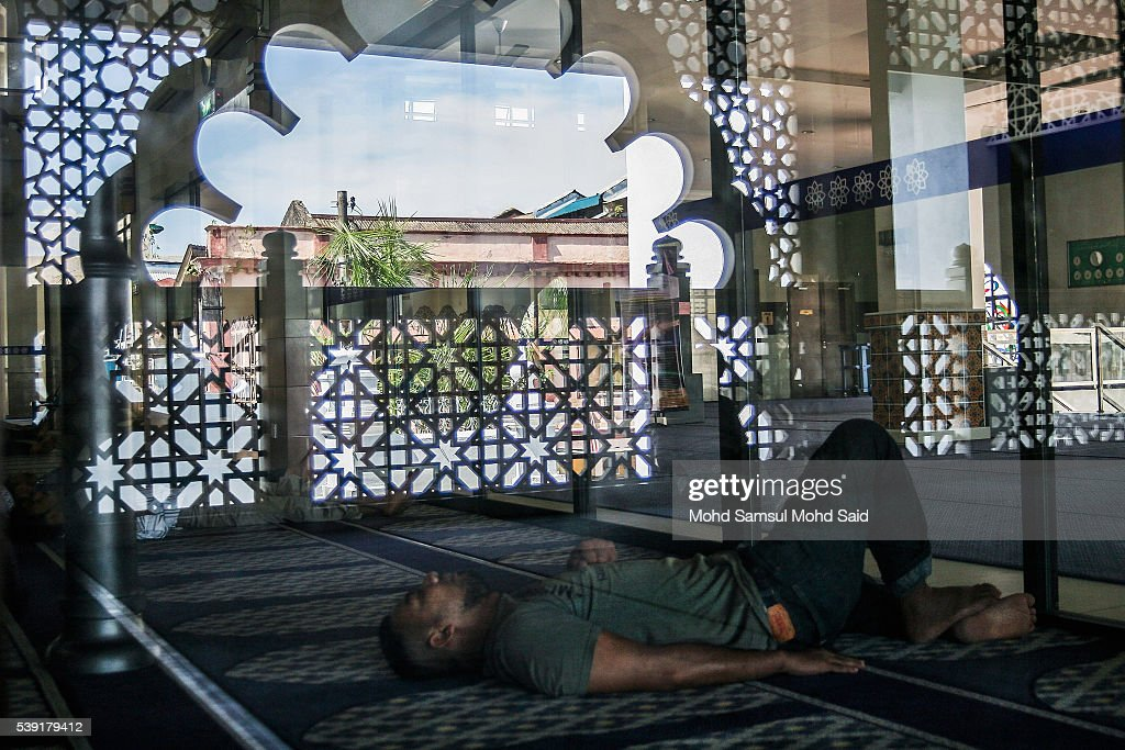 An Indian Muslim man rests inside the India Muslim mosque during the holy month of Ramadan on June 10, 2016 in Klang, Malaysia. Muslims around the world including Indonesia, Thailand and Arab state are observing the fasting month of Ramadan, Islam's holiest month, during which observant believers fast from dawn to dusk. They celebrate the end of the Ramadan with Eid al-Fitr festival.