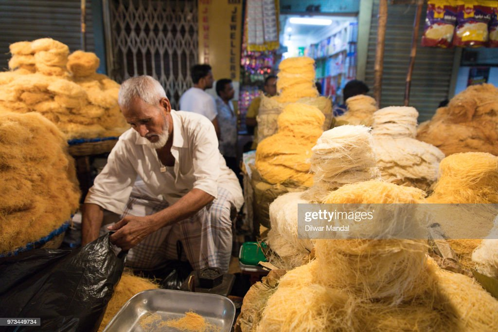 An Indian Muslim man sells delicious simui : Stock Photo