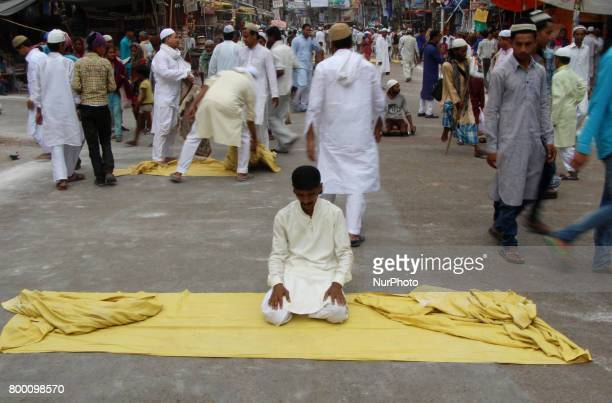 An indian muslim offers prayers on the last congregational friday of the holy month of Ramadan following the Muslim Festival Eid alFitr the biggest...
