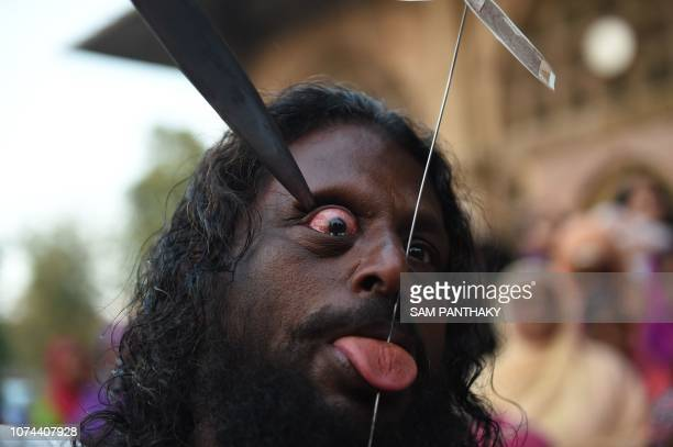 An Indian Muslim partially pierce his eye as he participates in a 'Rafai Silsila' during the commemoration of the 9th Urs or death anniversary of the...