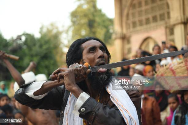 An Indian Muslim performs with a sword as he participates in a 'Rafai Silsila' during the commemoration of the 9th Urs or death anniversary of the...