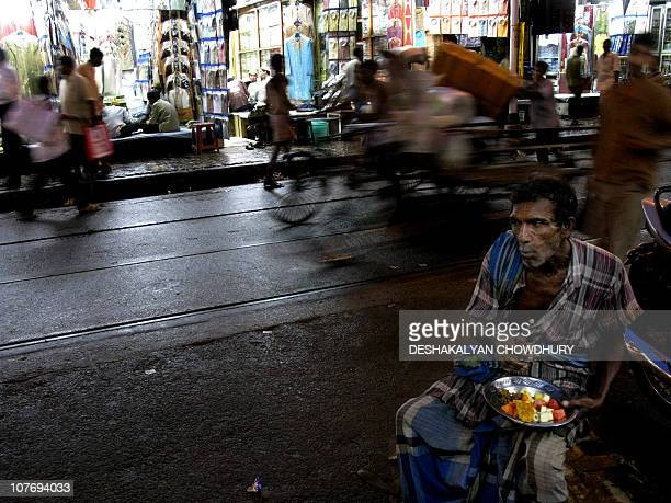 An Indian Muslim porter breaks his fast during the holy month of Ramadan at a market place in Kolkata on August 27 2009 During Ramadan Muslims are...