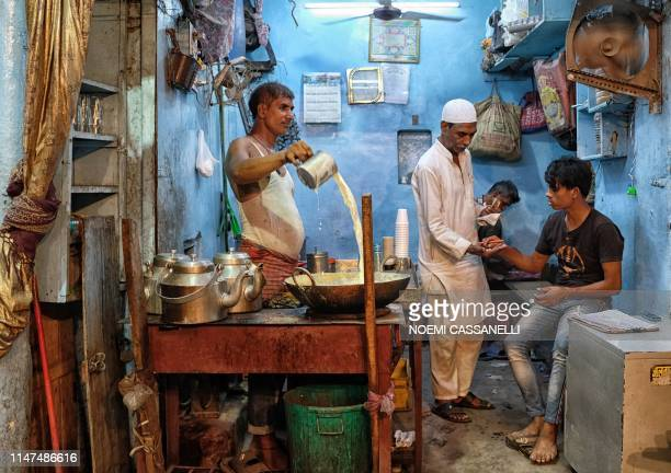 An Indian Muslim prepares hot milk early in the morning in the old quarters of New Delhi on June 2 during Shabe Qadr celebrating the night in which...