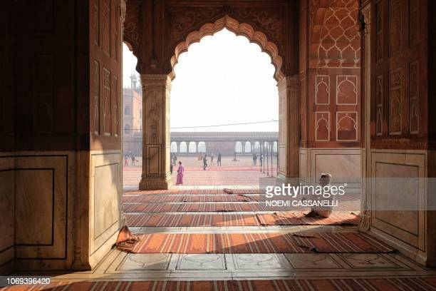 An Indian Muslim seen holding prayer beads sits in Jama Masjid in the old quarters of New Delhi on December 7 2018 The mosque commissioned by the...