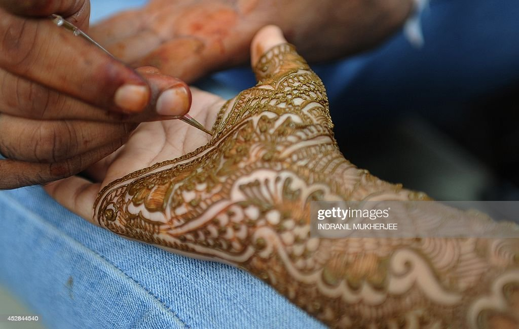 Simple Traditional Eid Al-Fitr Decorations - an-indian-muslim-woman-gets-her-hands-decorated-with-traditional-at-picture-id452844540  Gallery_677810 .com/photos/an-indian-muslim-woman-gets-her-hands-decorated-with-traditional-at-picture-id452844540