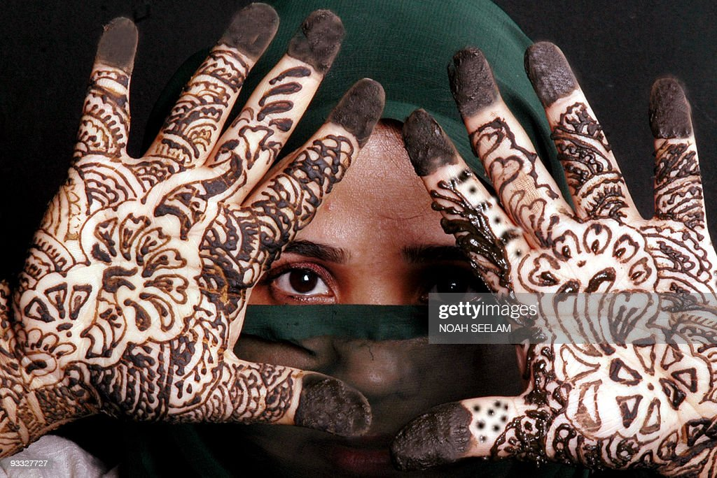 Must see Traditional Eid Al-Fitr Decorations - an-indian-muslim-woman-poses-showing-her-hands-decorated-with-mehendi-picture-id93327727  Trends_715529 .com/photos/an-indian-muslim-woman-poses-showing-her-hands-decorated-with-mehendi-picture-id93327727