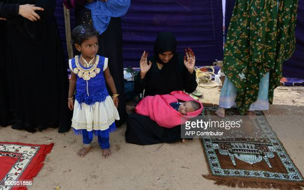 An Indian Muslim woman with her children offers Eid alFitr prayers in Chennai on June 26 2017 Muslims around the world are celebrating the Eid alFitr...