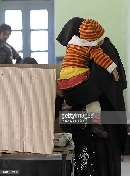 An Indian Muslim women casts her vote at a polling station in Muradnagar Uttar Pradesh on February 28 2012 The sixth phase of assembly polls is being...