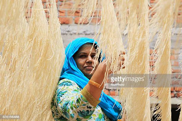 An Indian muslim women dries 'Vermicelli' used to make a traditional sweet dish popular during the Islamic holy month of Ramadan in Jaipur India...