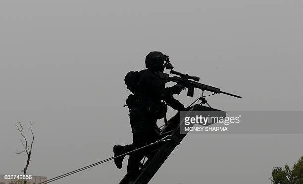 An Indian National Security Guard commando takes part in the 68th Republic Day parade in New Delhi on January 26 2017 Motorbike stunt riders and...