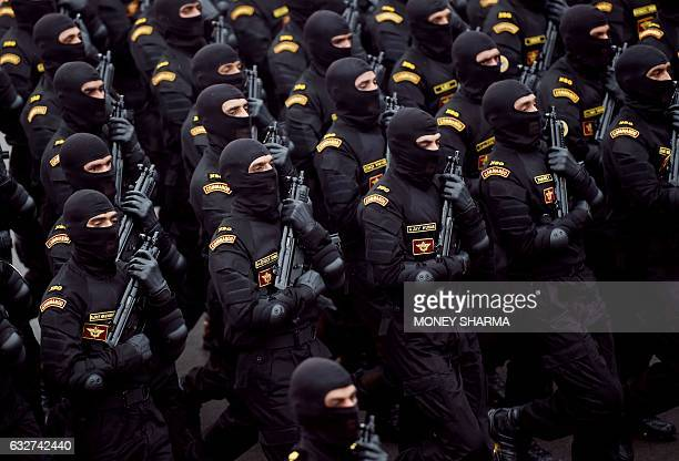 An Indian National Security Guard Commandos contingent march during the 68th Republic Day parade in New Delhi on January 26 2017 Motorbike stunt...