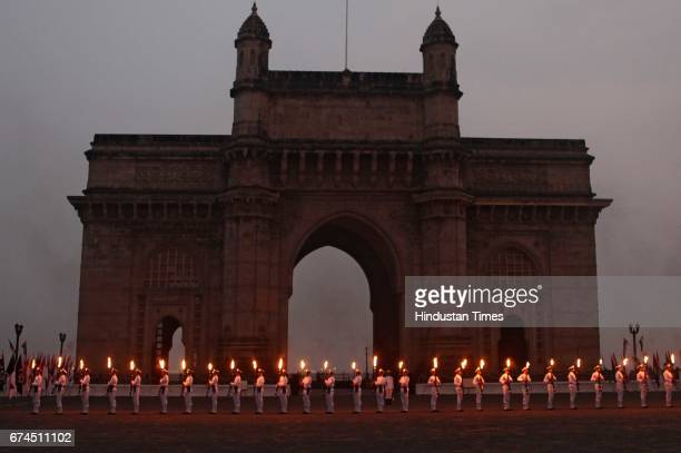 An Indian Naval Commandos perform during Naval Day celebrations at Gateway of India in Mumbai India