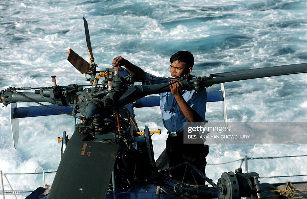An Indian naval engineer checks a helico : News Photo