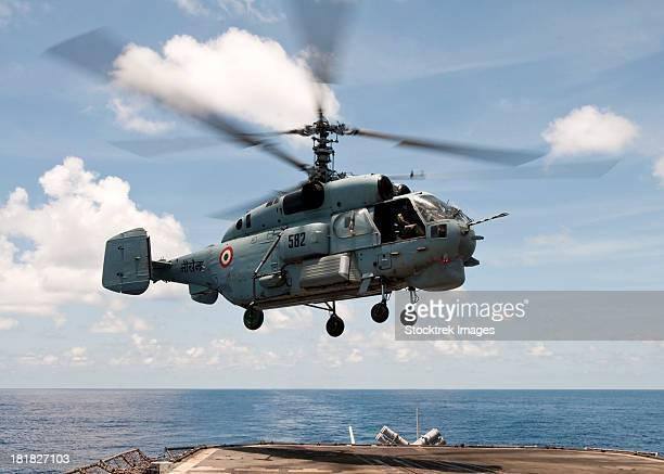 an indian navy kamov ka-31  lands on the flight deck of uss bunker hill. - indian military fotografías e imágenes de stock
