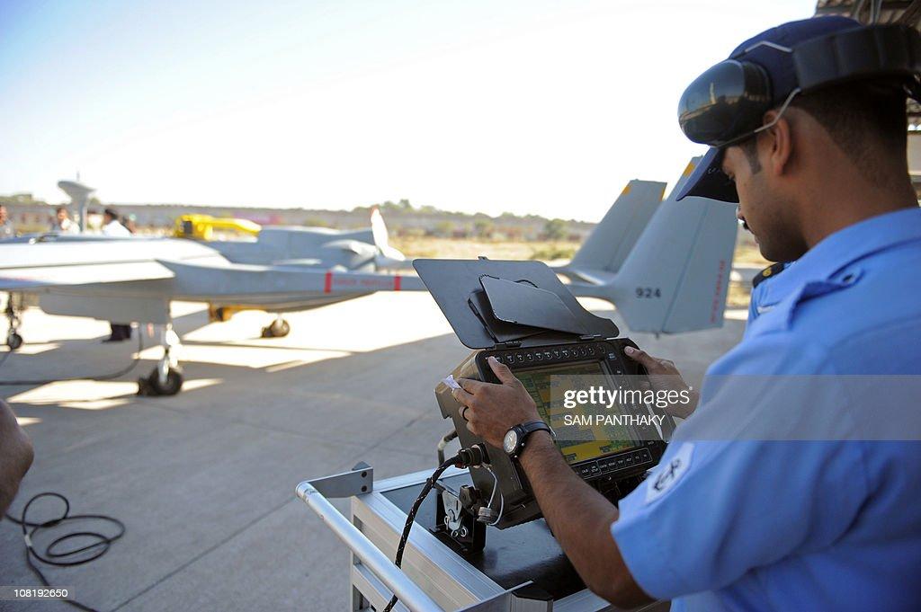"""An Indian Navy technician prepares a """"He : News Photo"""