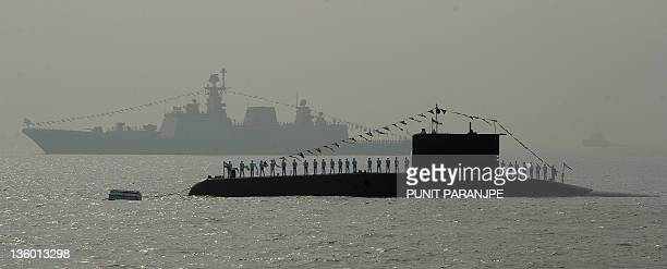 An Indian navy's submarine and a ship are seen during a the Fleet Review in Mumbai on December 20 2011 Indian President Pratibha Patil who reviewed a...