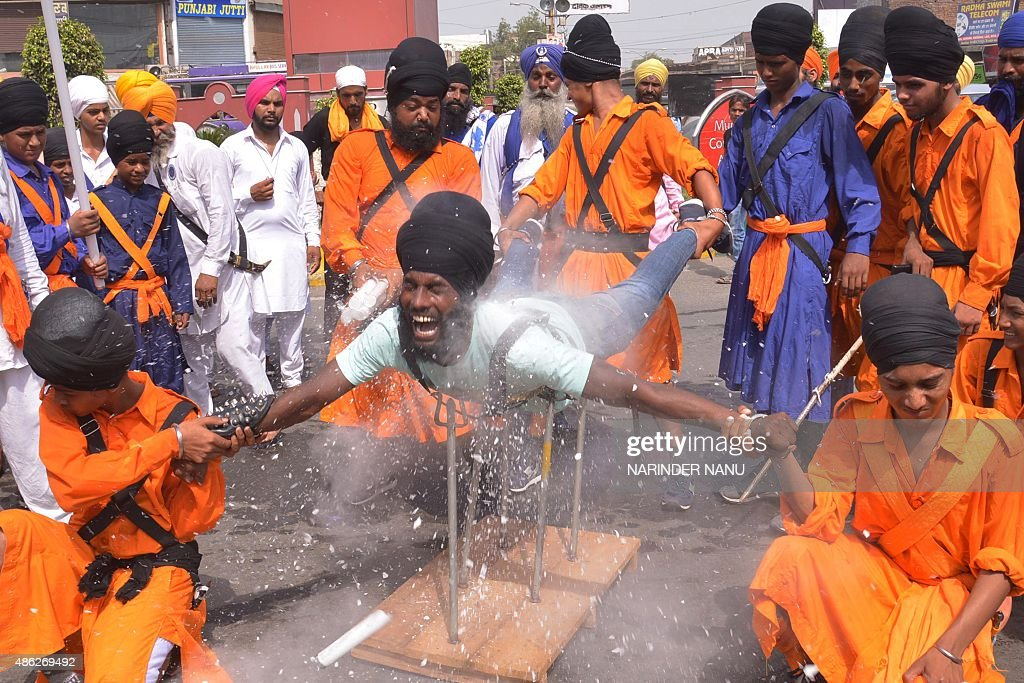 An Indian Nihang, a religious Sikh warrior, demonstrates Sikh martial arts skills known as 'Gatka' during a march to mark the 354th birth anniversary of the Sikh warrior Shaheed Baba Jiwan Singh at the Golden temple in Amritsar on September 3, 2015. The Sikhs are celebrating Shaheed Baba Jiwan Singh, a famous warrior from the Sikh religion who lived during the 17th century.