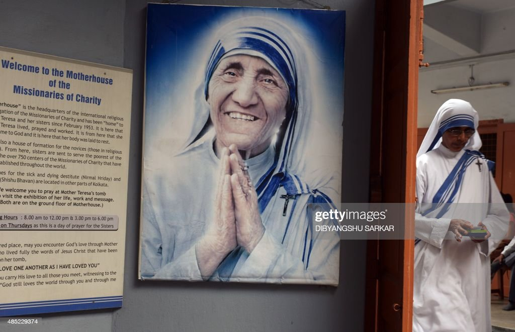An Indian nun from the Catholic Order of the Missionaries of Charity leaves after taking part in a mass to commemorate the 105th birthday of Mother Teresa at the Indian Missionaries of Charity house in Kolkata on August 26, 2015. Mother Teresa, a Nobel peace prize winner and Roman Catholic saint-in-waiting, was born on August 26, 1910 to Albanian parents in what is now Skopje in Macedonia. AFP PHOTO/Dibyangshu SARKAR /