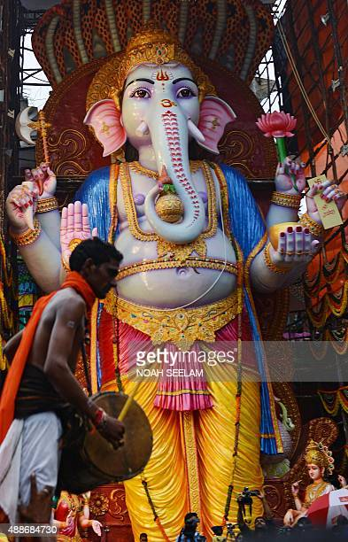 An Indian Oggu artist perform in front of a 59foottall tall idol of the Hindu god Lord Ganesh popularly known as 'Khairatabad Ganesh' on the occasion...