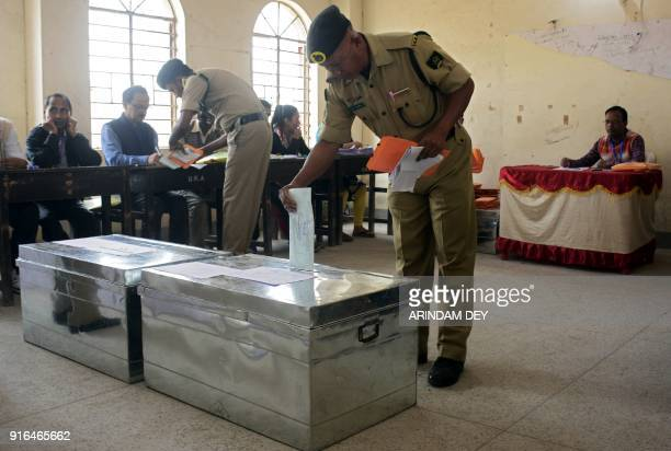 An Indian paramilitary force personnel recruited for election duty during the upcoming elections casts his vote in a ballot box during a postal...