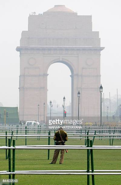 An Indian paramilitary official stands guard at Rajpath for the forthcoming Republic Day celebrations in New Delhi on January 22 2009 The countrywide...